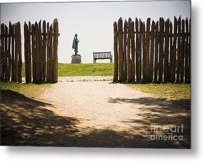 Wooden Fence And Statue Of John Smith Metal Print by Roberto Westbrook