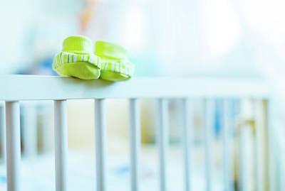 Baby Shoes On The Edge Of A Cot Poster by Wladimir Bulgar