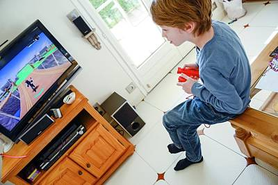 Boy Playing Wii Video Game Poster by Aj Photo