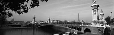 Bridge Across A River With The Eiffel Poster by Panoramic Images