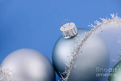 Christmas Baubles On Blue Poster by Elena Elisseeva