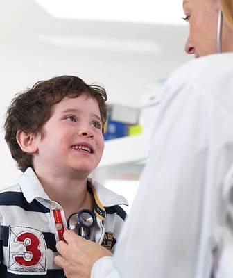 Doctor Examining Child Poster by Tek Image