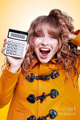 Excited Winter Woman Holding Savings Calculator Poster by Jorgo Photography - Wall Art Gallery