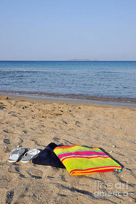 Flip Flops And Towels On Beach Poster by George Atsametakis