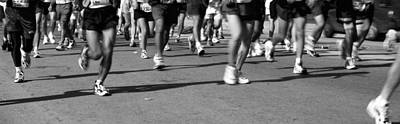 Low Section View Of People Running Poster by Panoramic Images