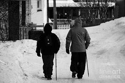 Middle Aged Couple Walking Along Snow Covered Street With Sticks Kirkenes Finnmark Norway Europe Poster by Joe Fox
