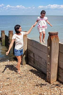 Mother And Daughter On Beach Poster by Ian Hooton