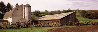 Old Barn With A Fence Made Of Wheels Poster by Panoramic Images