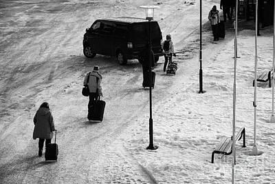 People Pulling Wheeled Luggage Walk Across Ice At Kirkenes Harbour  Finnmark Norway Europe Poster by Joe Fox