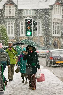 Shoppers Trudging Through Snow Poster by Ashley Cooper