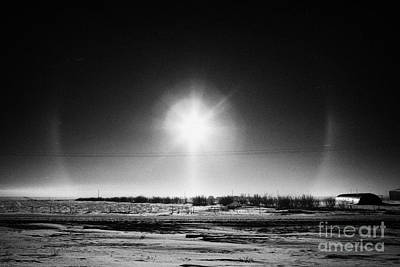 sun dog parhelion halo due to ice crystals surrounding the sun in Saskatchewan Canada Poster by Joe Fox