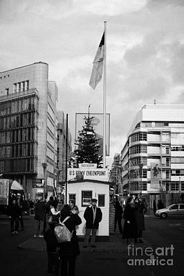 tourists at checkpoint charlie ersatz cabin reconstruction in the middle of Friedrichstrasse Berlin Poster by Joe Fox