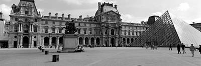 Black And White Paris Poster featuring the photograph Tourists In The Courtyard Of A Museum by Panoramic Images
