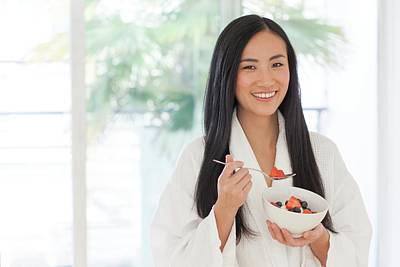 Woman Holding Bowl Of Fruit Poster by Ian Hooton