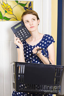 Woman Planning Shopping Budget With Calculator Poster by Jorgo Photography - Wall Art Gallery