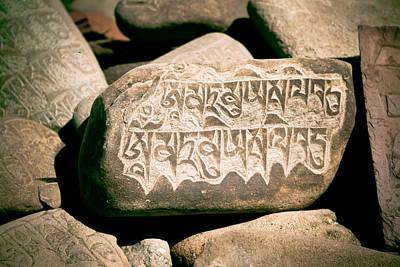 writing on the Tibetan language and Sanskrit at stone Poster by Raimond Klavins