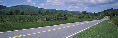 Road Passing Through A Landscape Poster by Panoramic Images