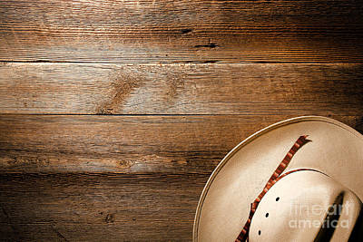 Cowboy Hat On Wood Poster by Olivier Le Queinec