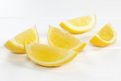 Lemon Wedges On White Background Poster by Colin and Linda McKie