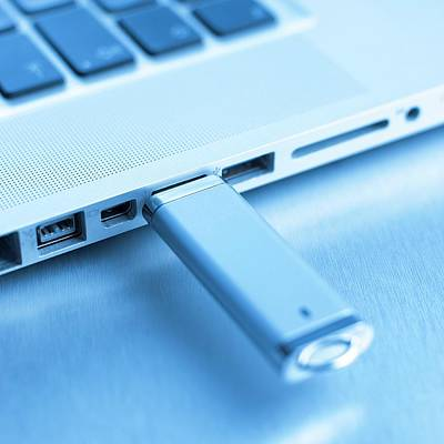 Usb Memory Stick And Laptop Poster by Science Photo Library
