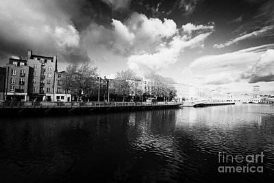 View Of The River Liffey And Hapenny Bridge Dublin Republic Of Ireland Poster by Joe Fox
