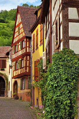 Village Street Scene In Kaysersberg Poster by Brian Jannsen