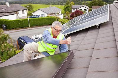 Workman Fitting Solar Thermal Panels Poster by Ashley Cooper