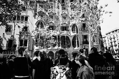 tourists tour group outside casa batllo modernisme style building in Barcelona Catalonia Spain Poster by Joe Fox