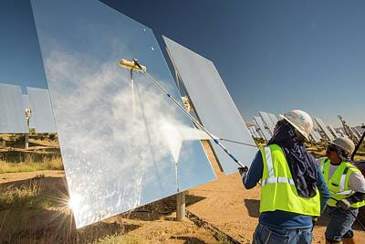 Workers Washing The Heliostats Poster by Ashley Cooper