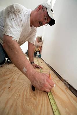 Repairing Hurricane Katrina Damage Poster by Jim West