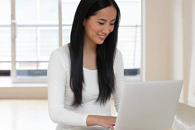 Woman Using Laptop Poster by Ian Hooton