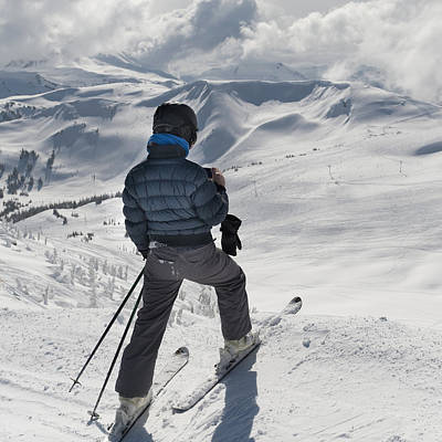 A Skier Pauses On The Trail To Look Out Poster by Keith Levit
