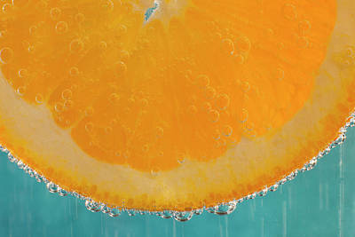 A Slice Of Orange In A Glass Poster by Brian Jannsen