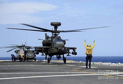 A U.s. Army Ah-64e Apache Guardian Poster by Stocktrek Images