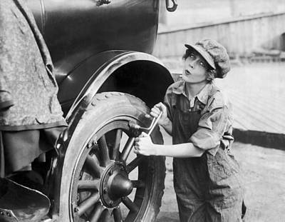 Actress Working On Her Car Poster by Underwood Archives