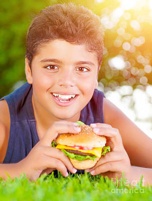 Arabic Boy Eating Burger Outdoors Poster by Anna Omelchenko