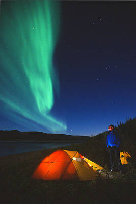 Aurora Borealis Above A Tent And Camper Poster by Peter Mather