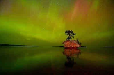 Aurora Over Honeymoon Rock In Lake Superior Poster by Jeff Rennicke