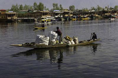 Balancing Large Bags On A Small Boat In The Dal Lake In Srinagar Poster by Ashish Agarwal
