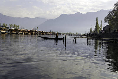Boatman On A Small Wooden Boat Near The Shore Of The Dal Lake Poster by Ashish Agarwal