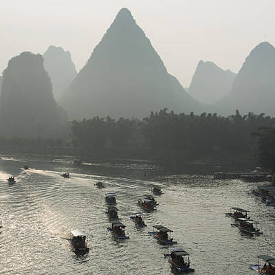 Boats Along The Li River At Sunset Poster by Keith Levit