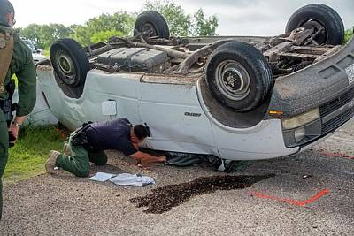 Border Patrol Officer Inspecting A Crash Poster by Jim West
