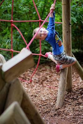 Boy Playing On Climbing Frame Poster by Samuel Ashfield
