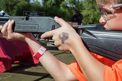 Boy Shooting A Bb Gun Poster by Jim West