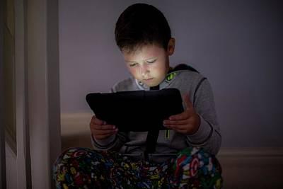 Boy Using A Digital Tablet In The Dark Poster by Samuel Ashfield