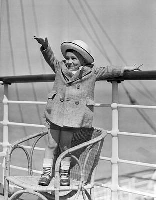 Boy Waving On Ocean Liner Poster by Underwood Archives
