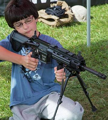 Boy With Automatic Rifle Poster by Jim West