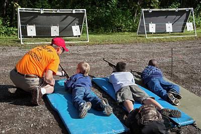 Boys Shooting Bb Guns Poster by Jim West