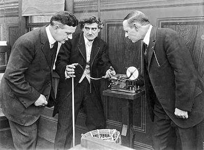 Brokers Checking Ticker Tape Poster by Underwood Archives