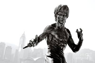 Bruce Lee Statue On The Avenue Of Stars With Hong Kong Skyline Poster by David Lyons